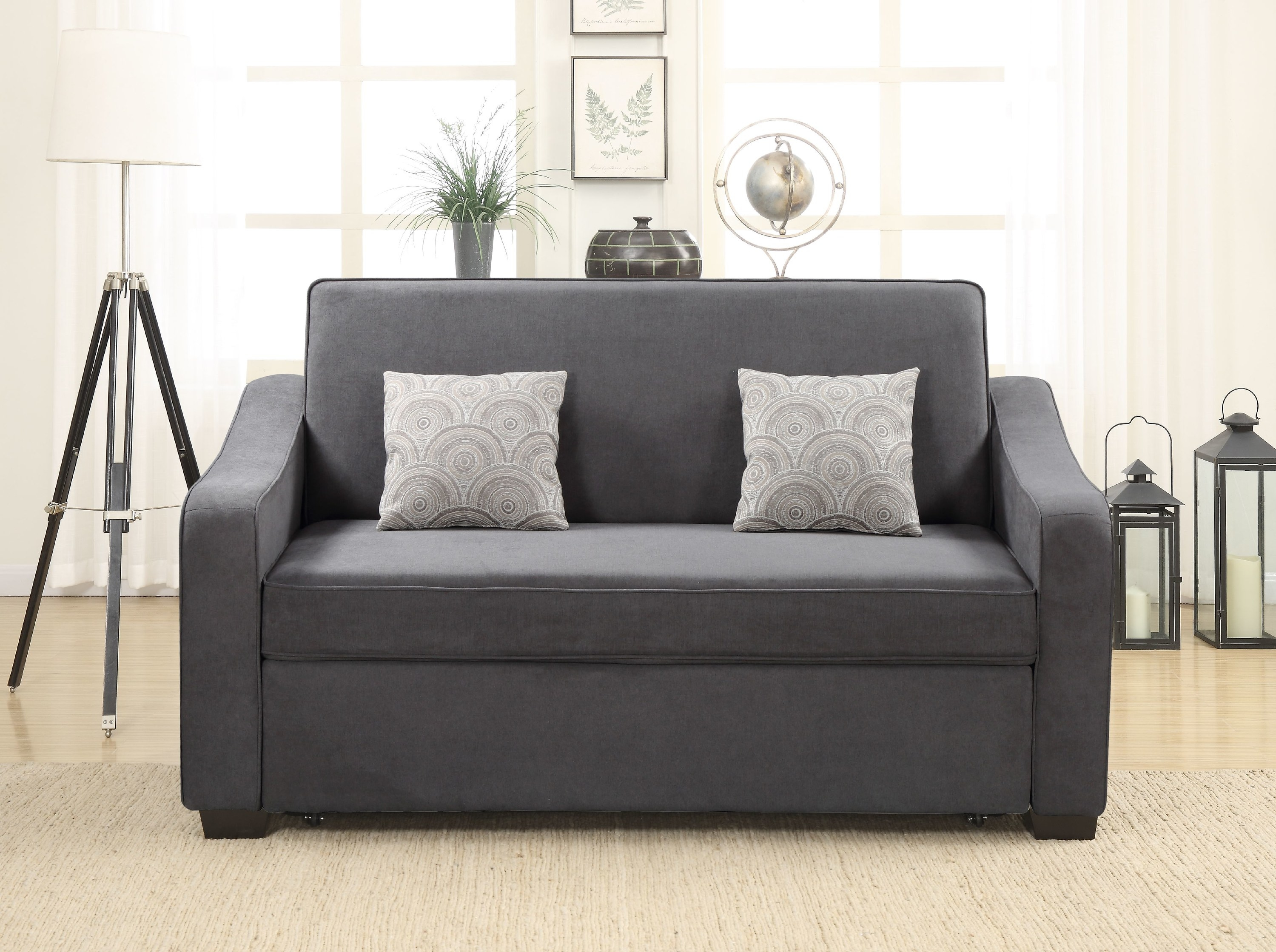 The compact gray sofa that can seat about two people