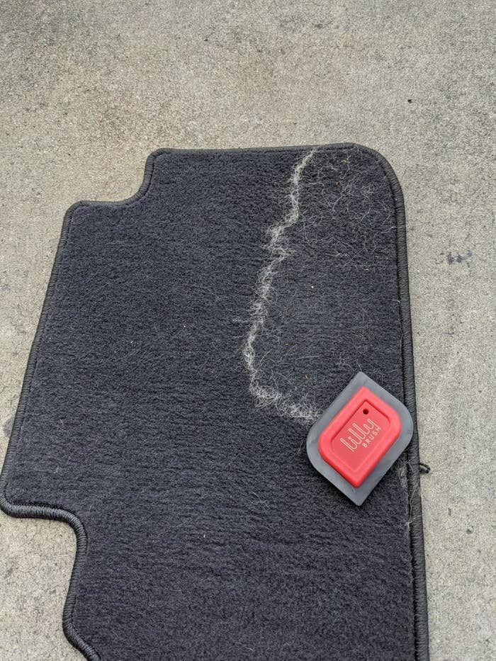 Reviewer photo of their car's carpets and you can clearly see the pile of fur that the detailer has removed from the carpet