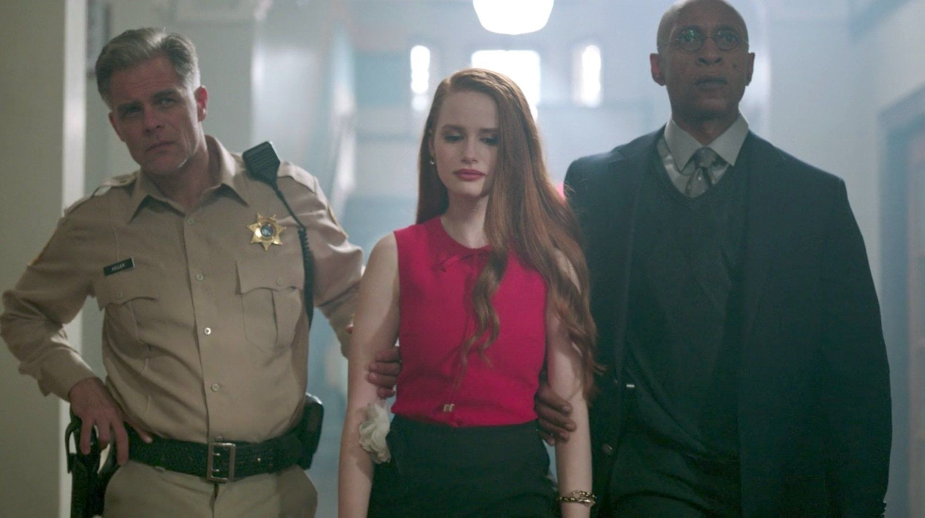 Cheryl being led away by the principal and Sheriff Keller