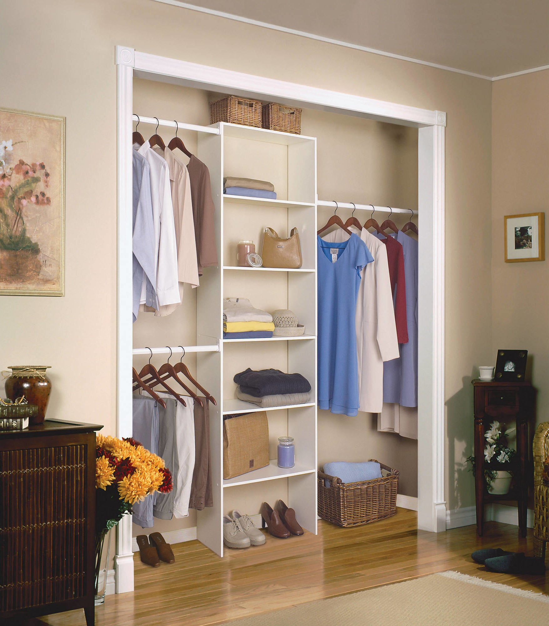 The tall white organizer, with six shelves and three rods, in a closet