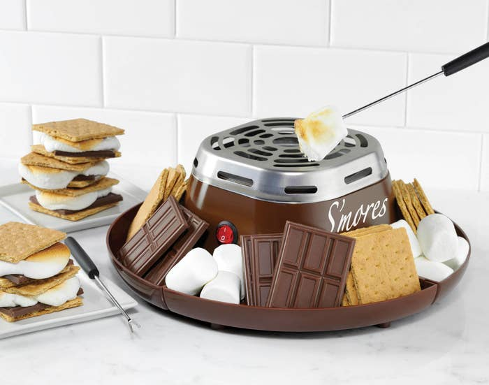 The s'mores maker, with a tray for the ingredients and a little stovetop in the middle to roast the marshmallows