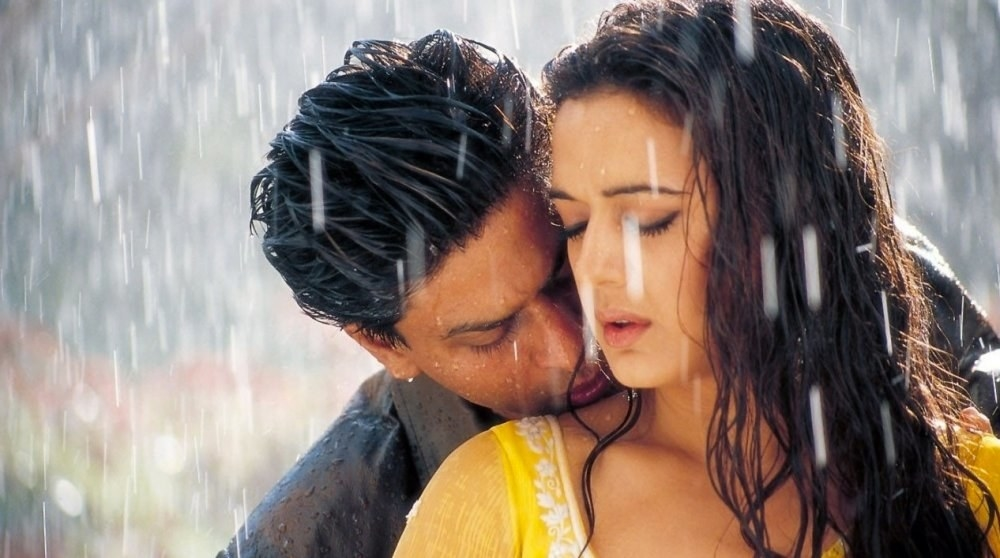 Shah Rukh Khan and Preity Zinta nuzzling in the rain in pure Bollywood fashion