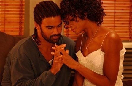 Kiberly Elise and Shemar Moore sitting close, hands entwined, in Diary of a Mad Black Woman