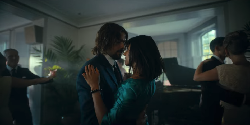Diego and Lila dancing closely together while looking into each other's eyes