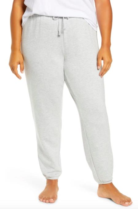 A model wearing the BP. fleece jogger pants in gray pearl heather.