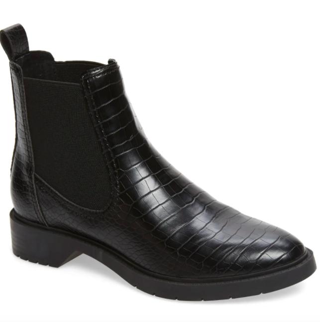 A pair of  the Treasure & Bond Gabriella Chelsea Boots in black croc.