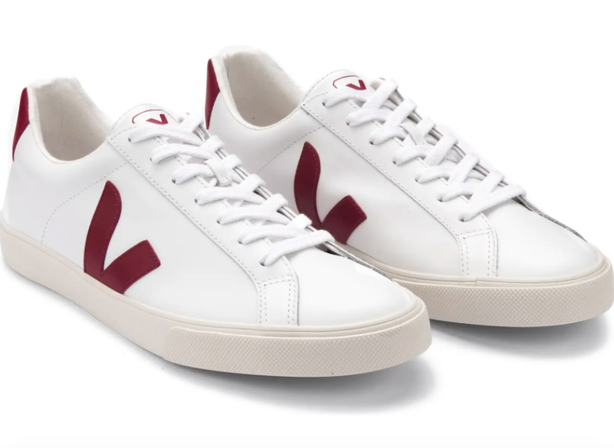 A pair of Veja Esplar sneakers designed in white with red details.