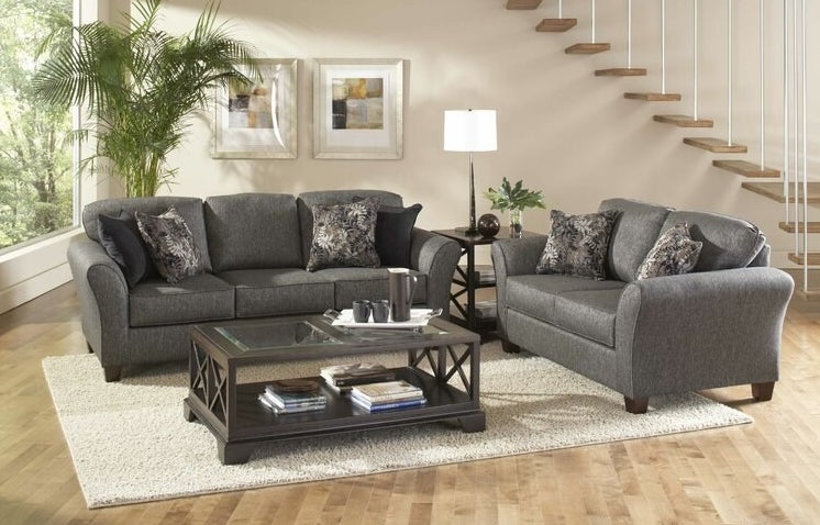 The gray sofa with matching loveseat