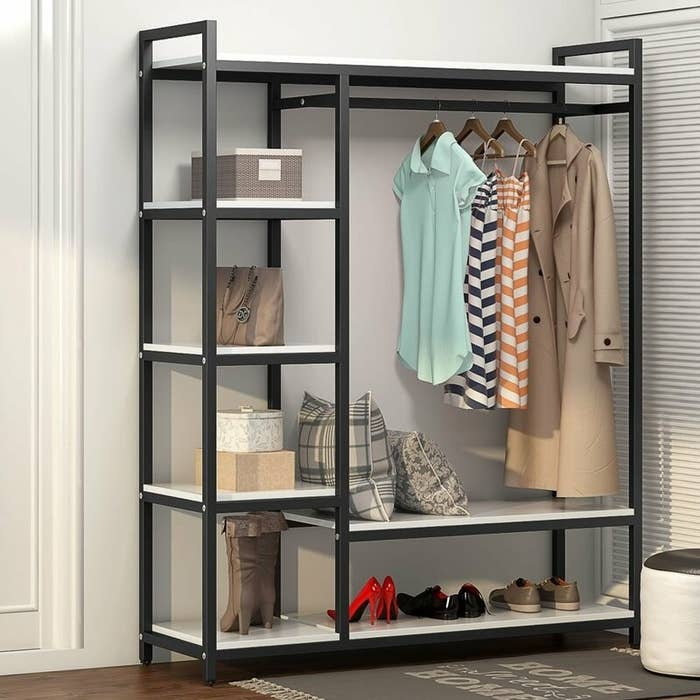 The closet system displaying clothes and shoes
