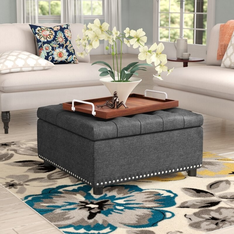 The ottoman used as a coffee table