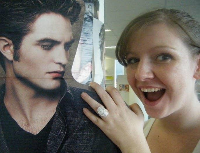 Woman wearing a replica Bella Swan engagement ring, posing with cardboard cutout Edward Cullen