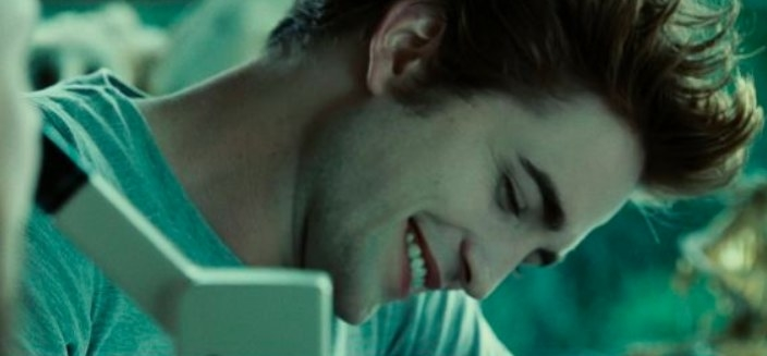 Still from Twilight: Edward Cullen smiling while looking down