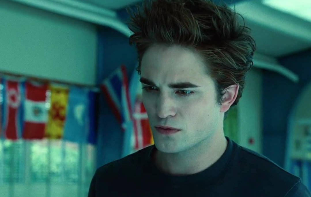 Still from Twilight: close-up of Edward Cullen in the school cafeteria
