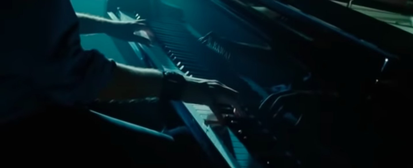 Still from Twilight: Edward's hands playing the piano