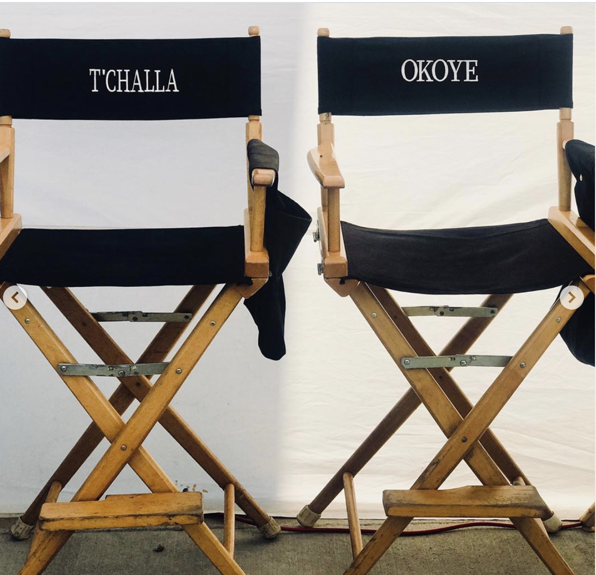 Empty director chairs for T'Challa and Okoye