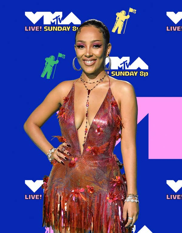 Doja Cat posed in a dress with a deep v-cut