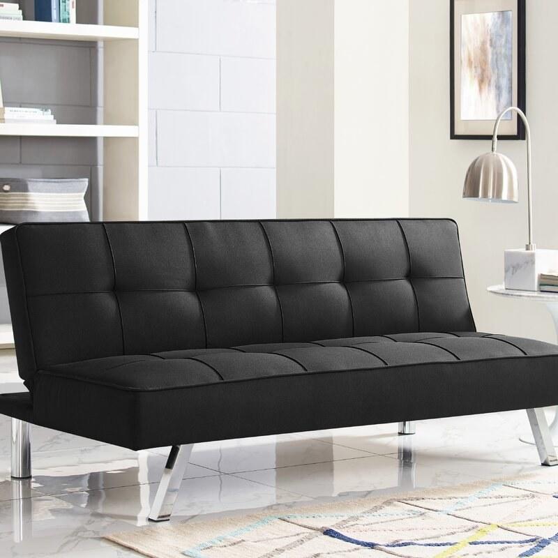 The black tufted sofa futon with silver metallic legs