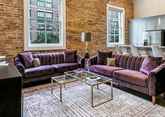 Two of the purple velvet couches