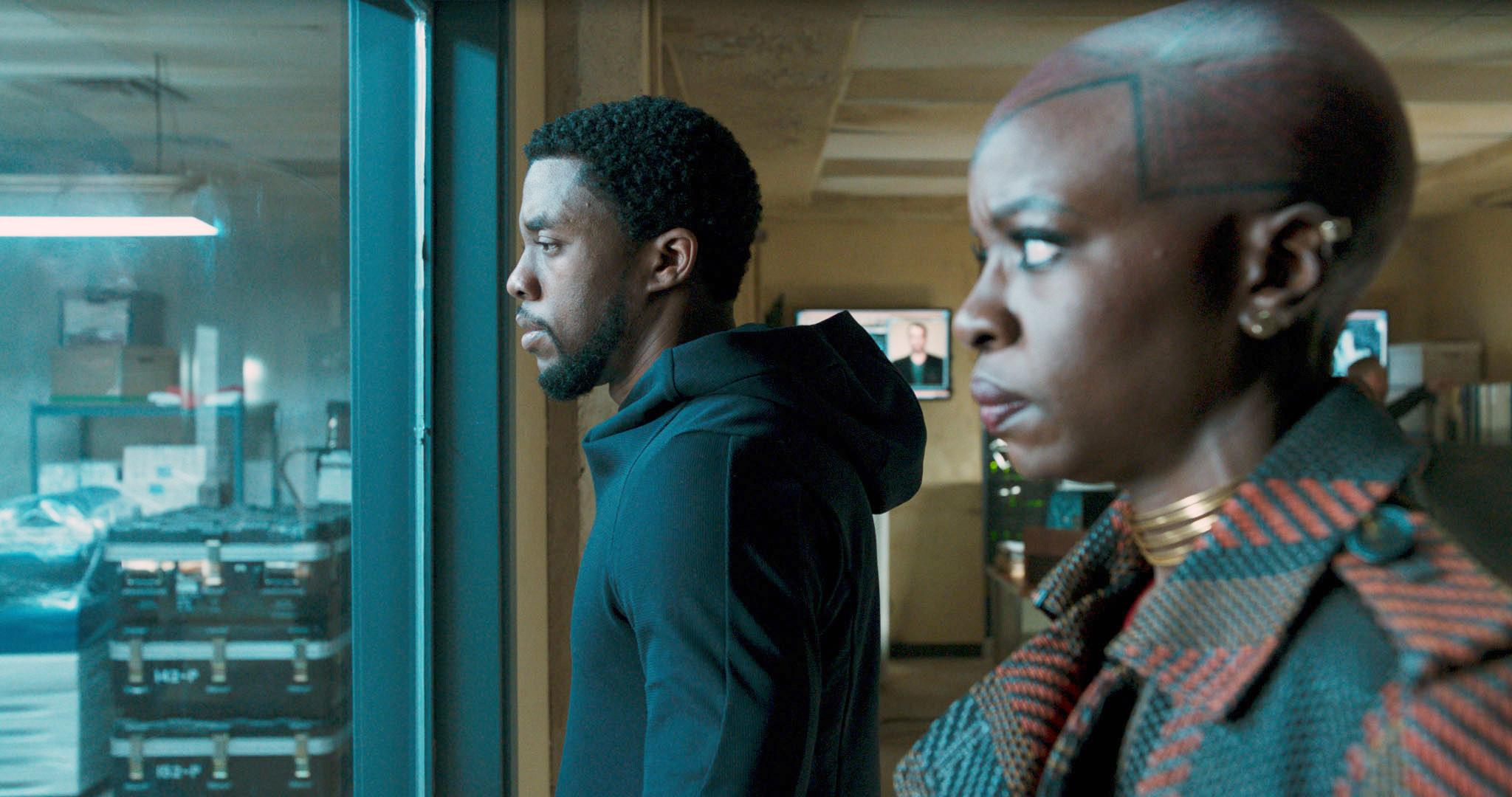 """Chadwick Boseman and Danai Gurira staring out a window in """"Black Panther"""""""