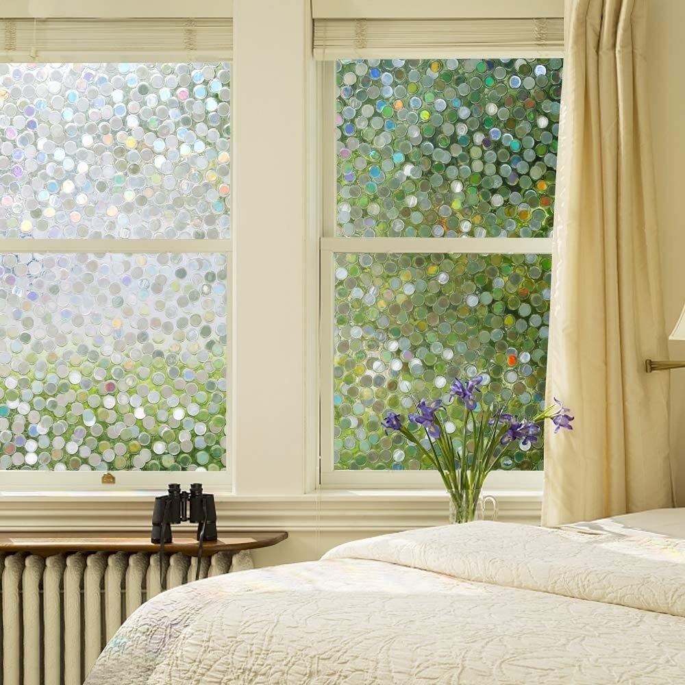 The window covering on four window panels in a bedroom