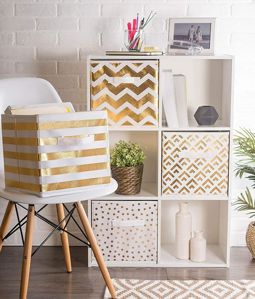 The fabric storage bins in a shelving unit