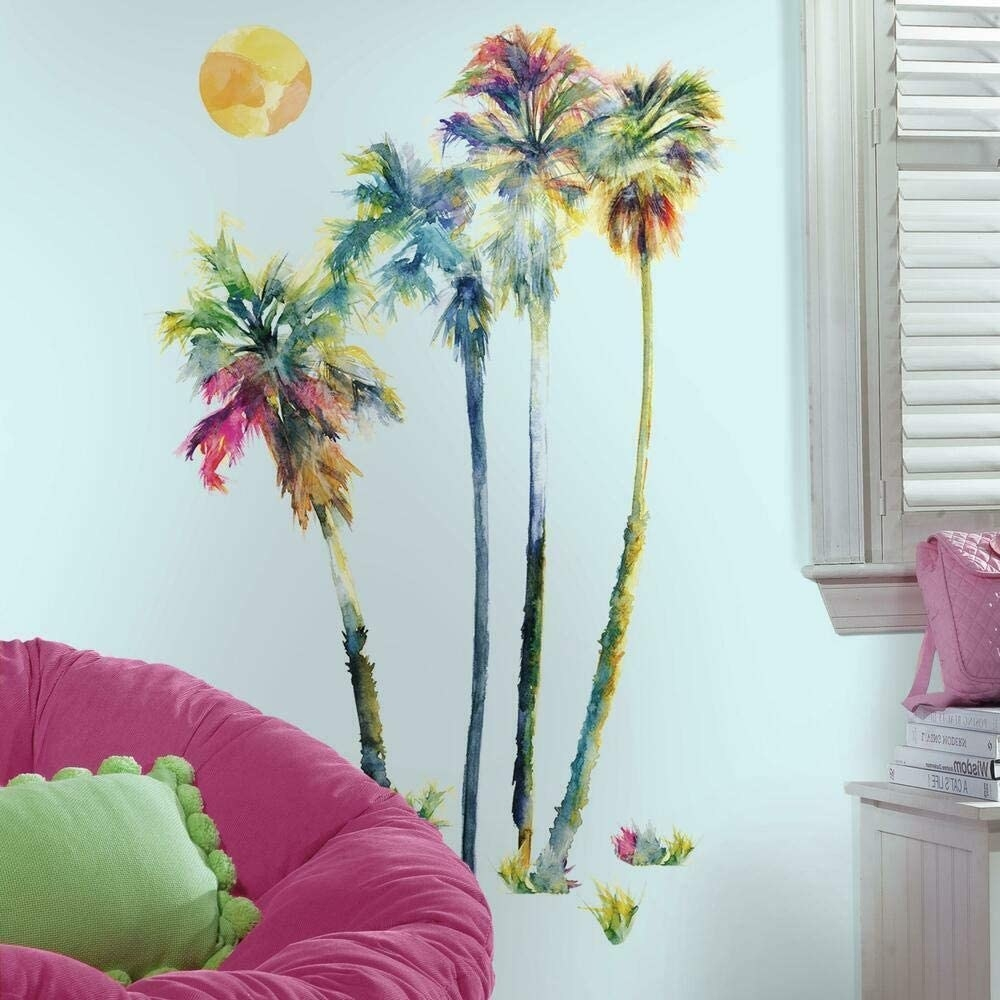 Palm tree wall stickers behind a round chair