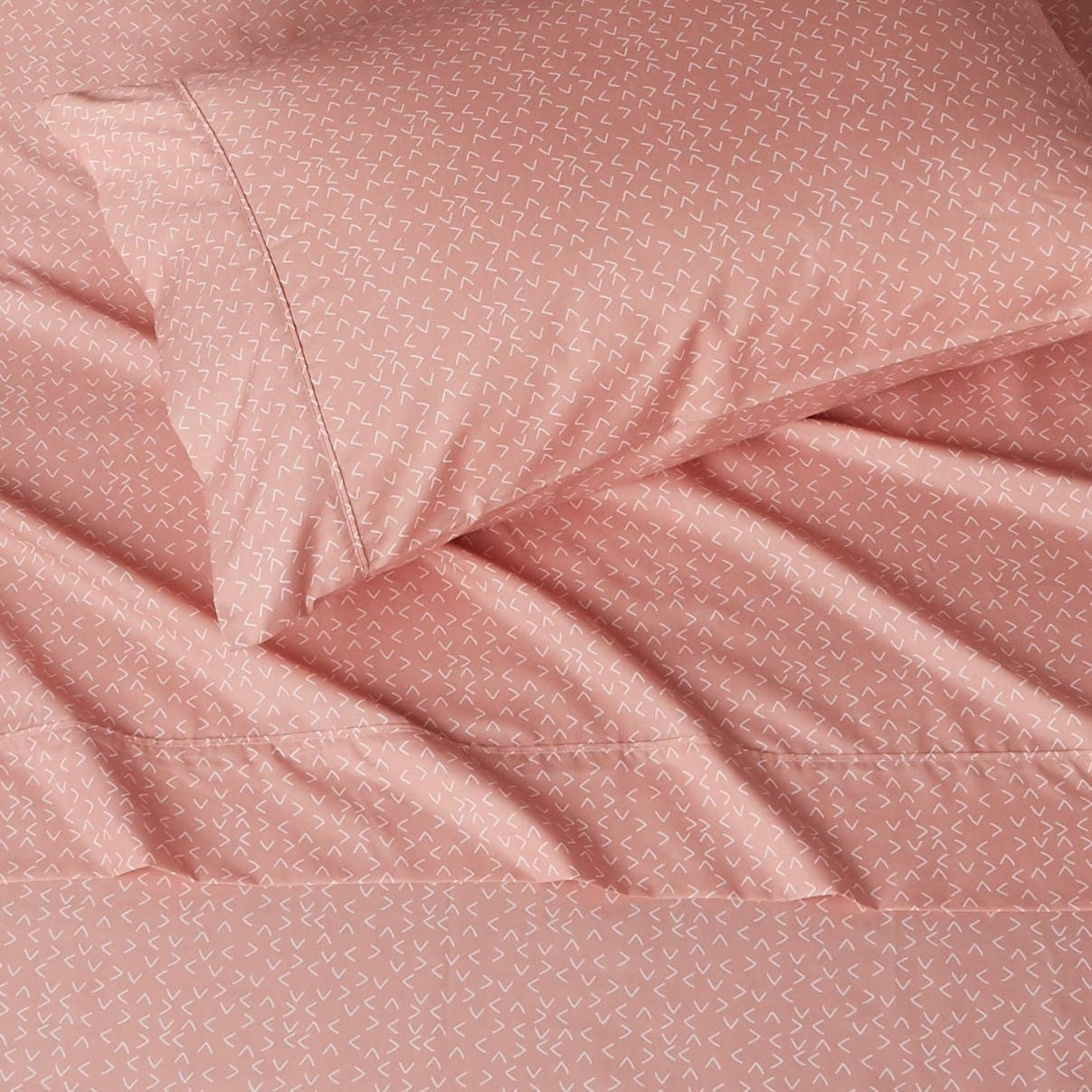 The flat sheet and pillowcase on a bed