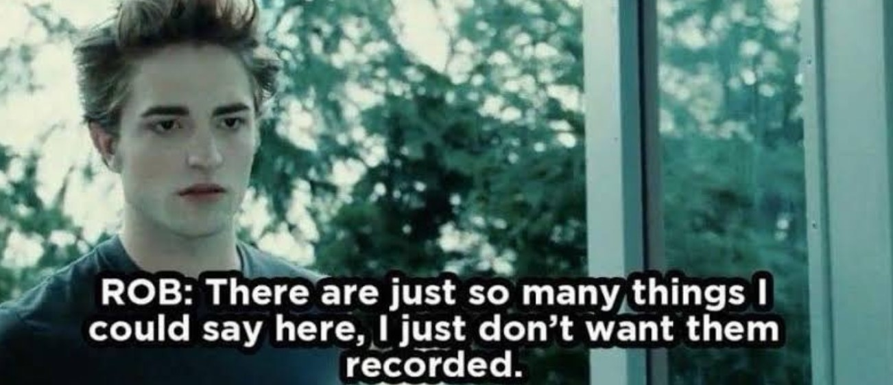 """Still from Twilight: Edward entering the cafeteria. Text on image: Robert Pattinson, from the commentary track, saying """"there are just so many things I could say, I just don't want them recorded."""""""