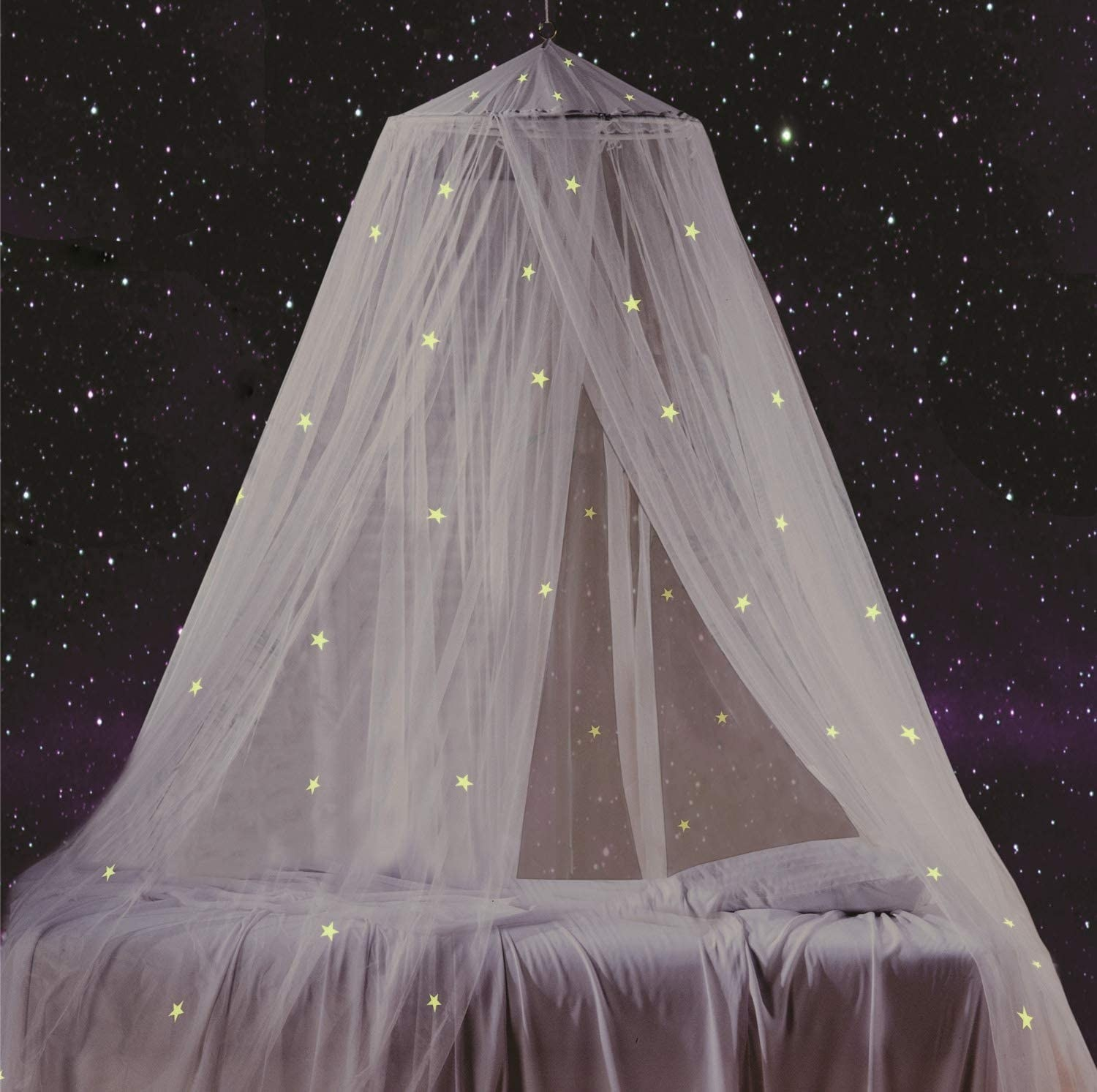 A mesh bed canopy hanging overtop of a bed