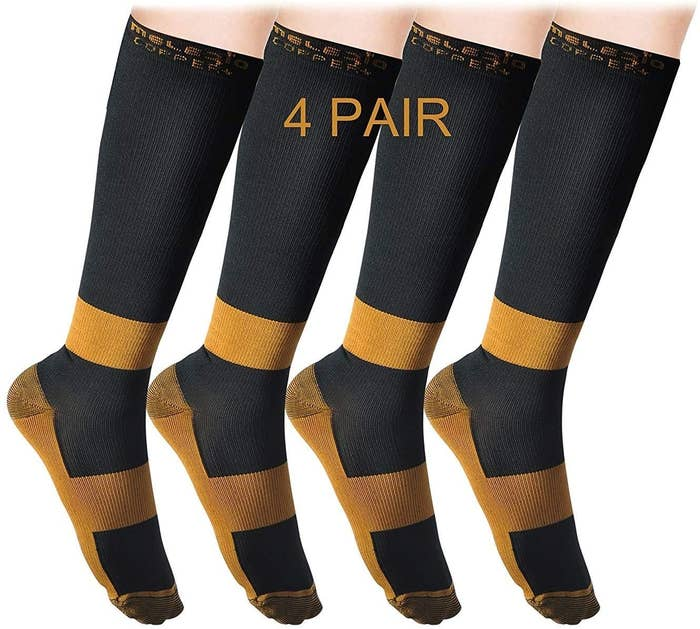 four pairs of the knee-high socks showing the multiple copper-infused bands of fabric