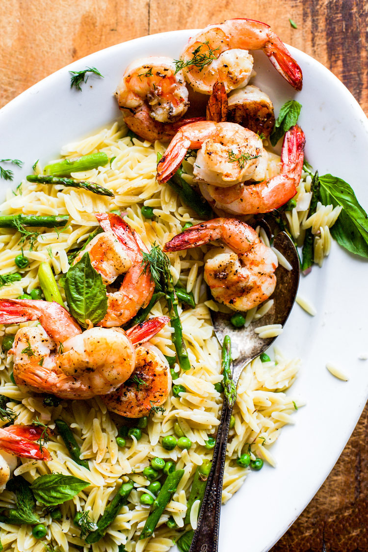 A big platter of orzo with asparagus, peas, and grilled shrimp.