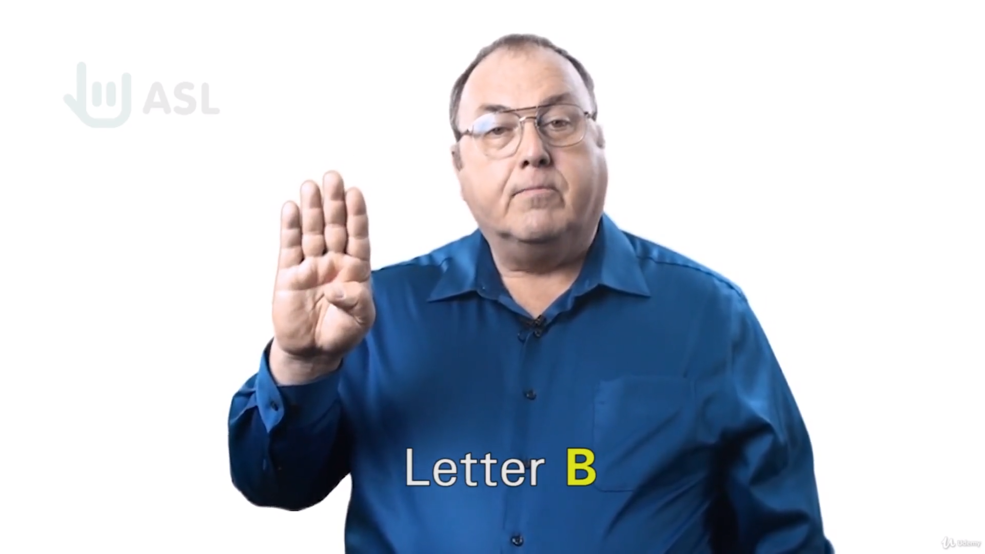 A person making the letter B with their hand using American Sign Language