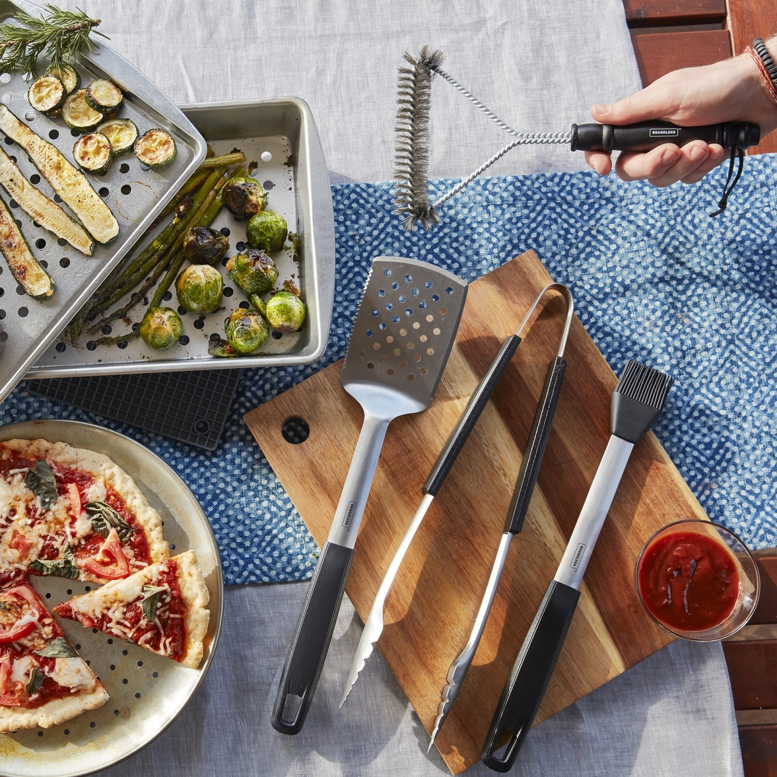 The bundle, including grilling tools and trays
