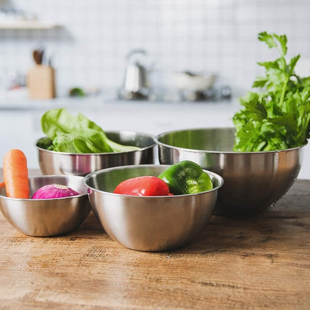 four bowls of different sizes holding produce