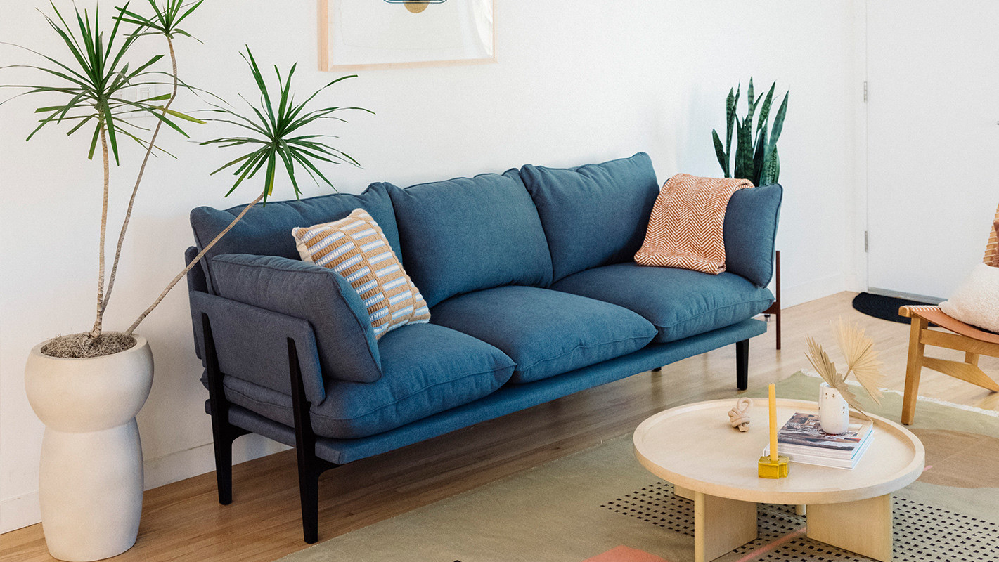 The three-seater sofa in the color Ocean Dive