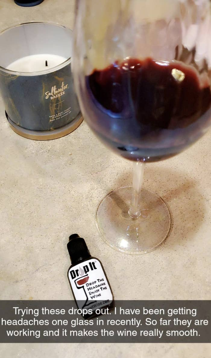 Reviewer image of glass of red wine with a bottle of Drop It, along with a caption explaining that it's been working