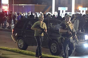 Kyle Rittenhouse and another militia member carrying assault rifles during a night of protest in Kenosha.