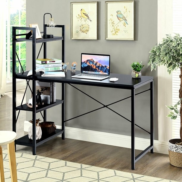 """The black Costway 47.5"""" Computer Desk Writing Desk Study Table Workstation With 4-Tier Shelves in an office"""