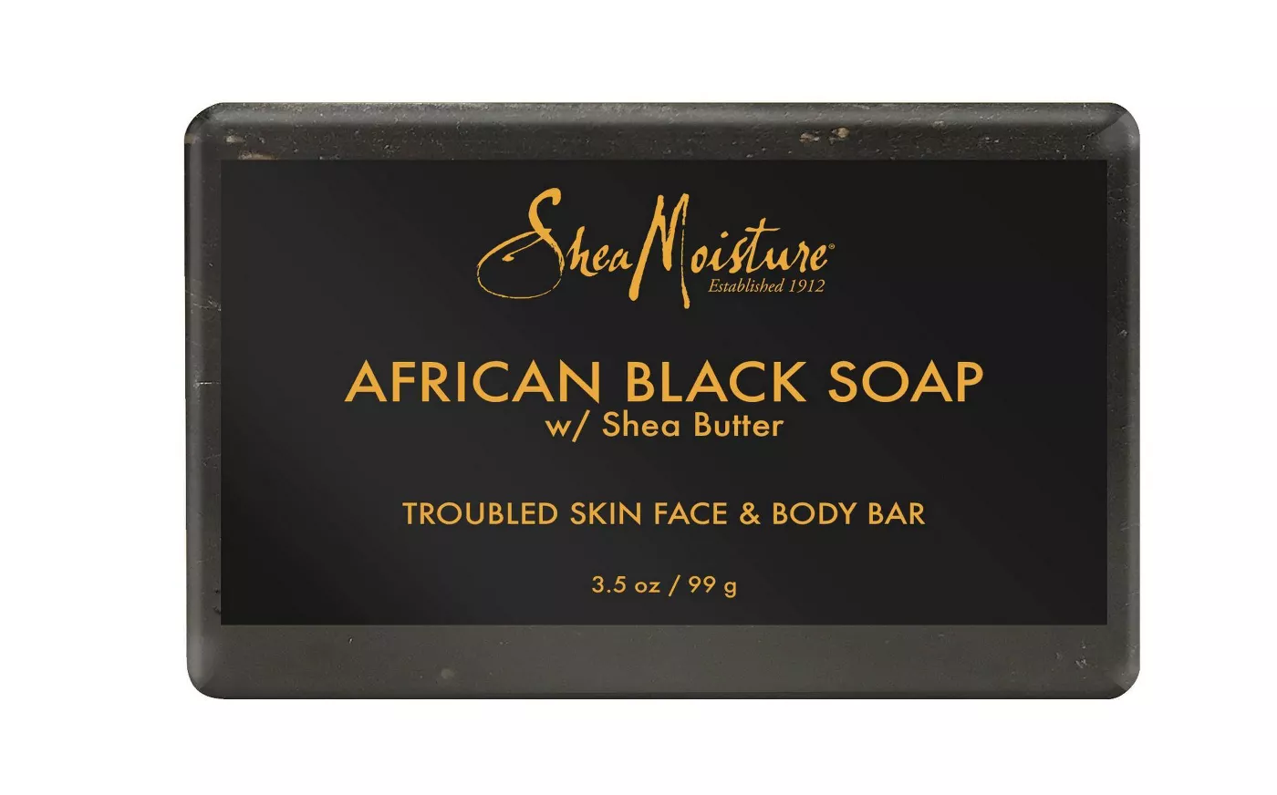 A  bar of African Black Soap with a black label and yellow branding