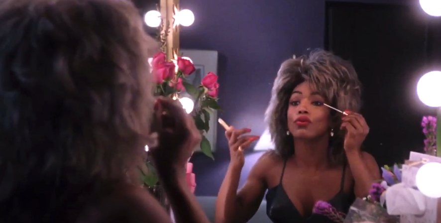 """Angela Bassett as Tina Turner in """"What's Love Got to Do with It"""" putting makeup on in front of a mirror"""