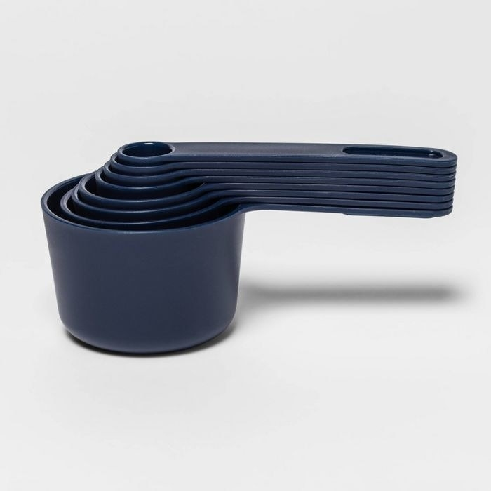 blue measuring cup and spoon set nesting inside each other