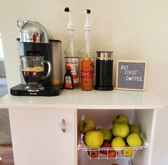The Nespresso machine displayed in an at-home barista-style coffee corner