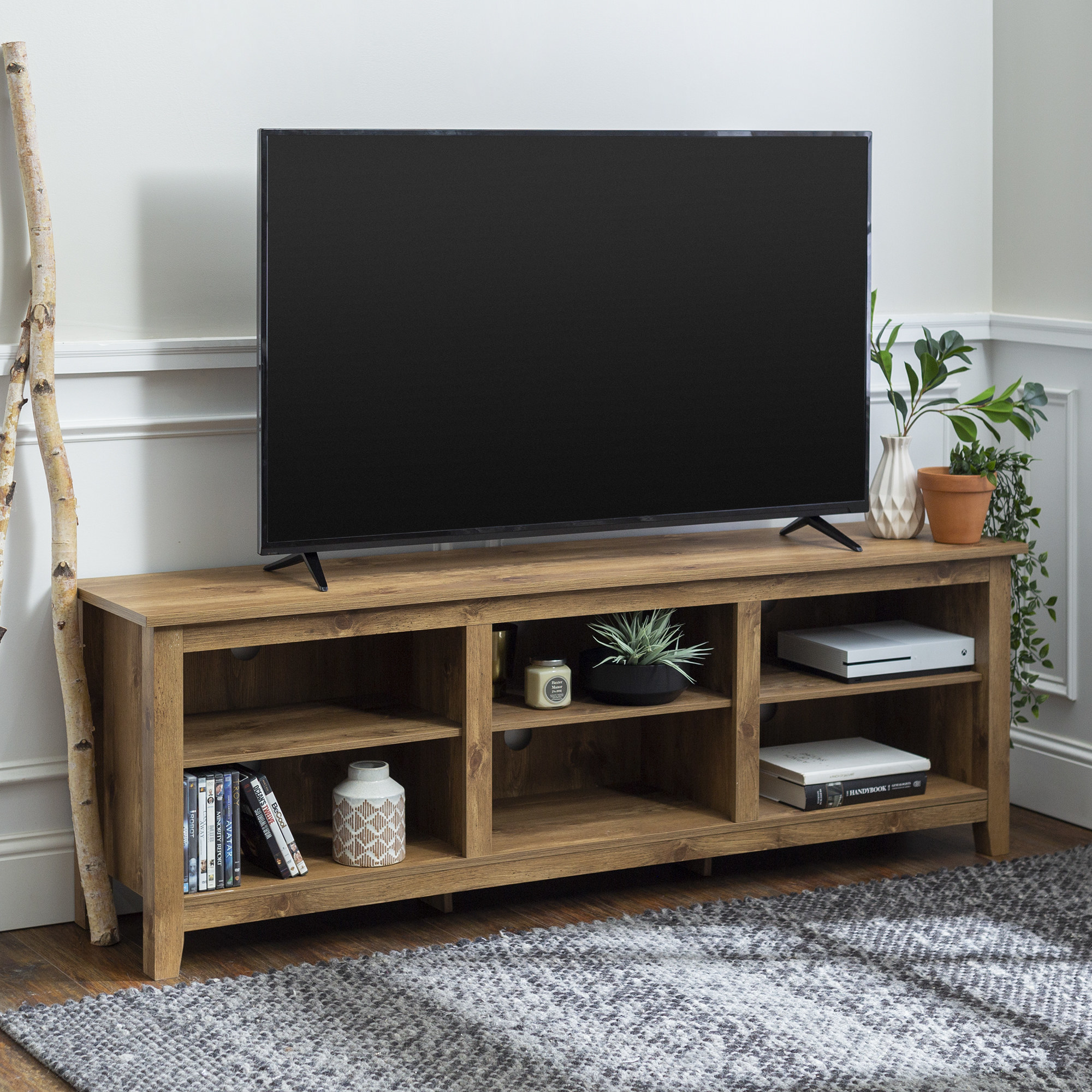 The tan TV stand