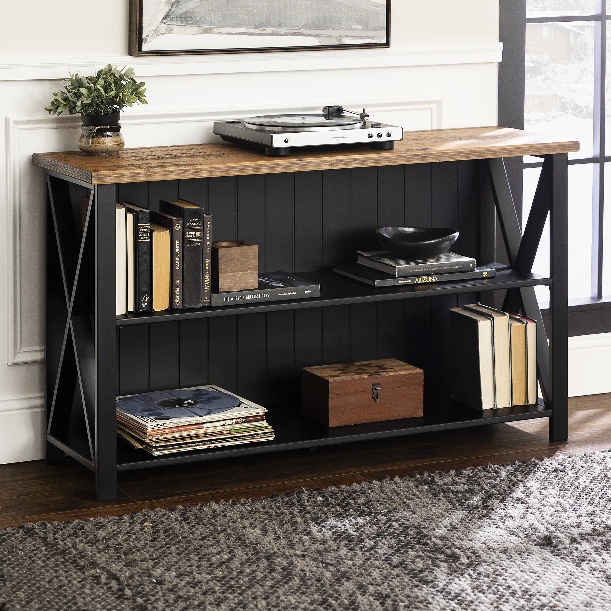 The tan and black console