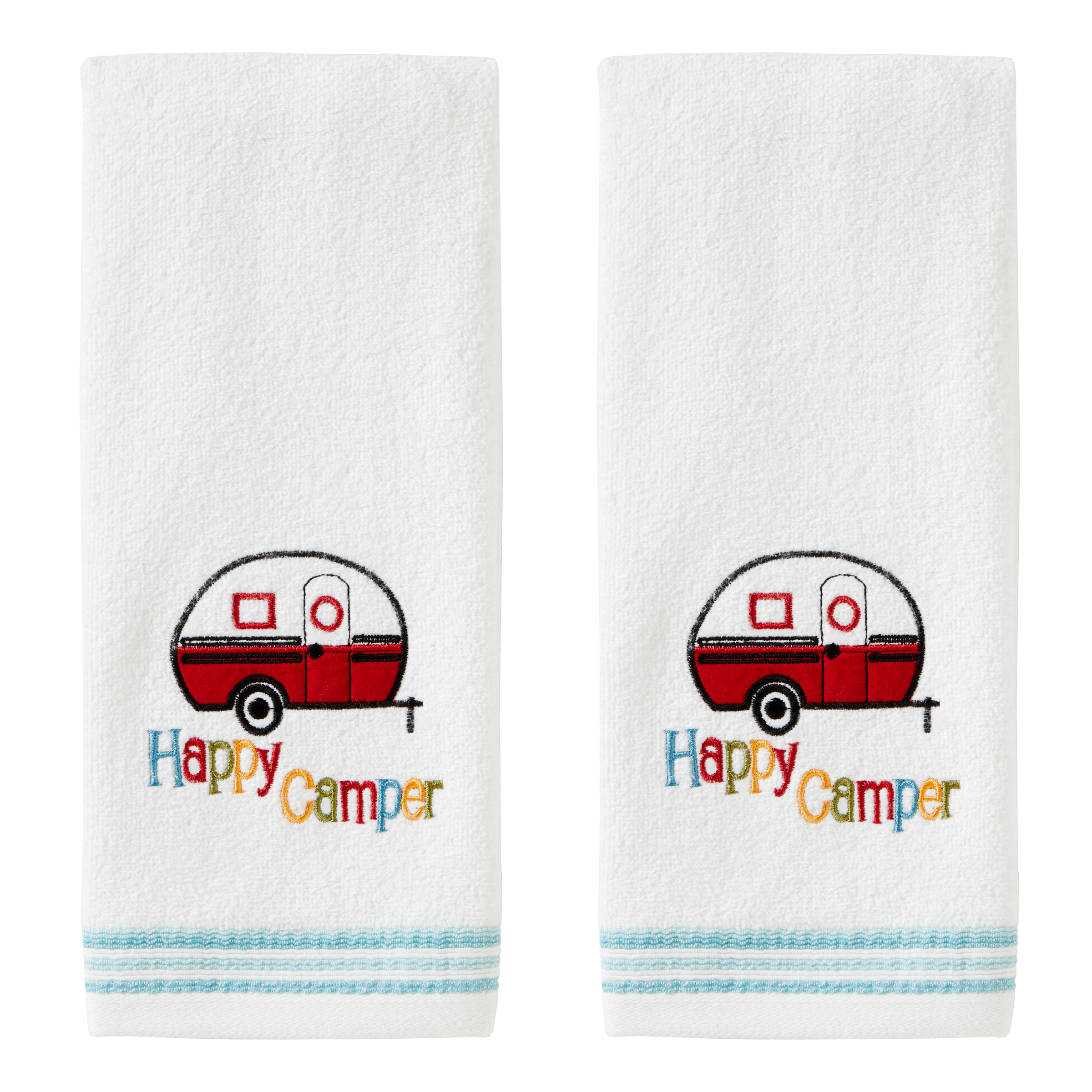 """The hand towels, with embroidery of a camper and the multicolored words """"Happy Camper"""""""