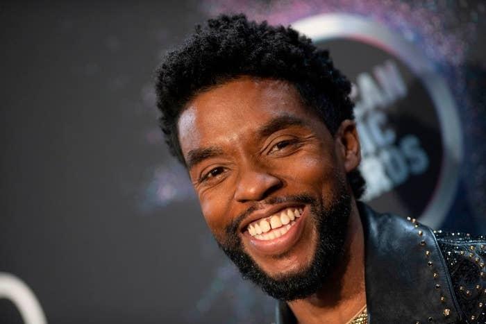 Chadwick Boseman smiling on red carpet