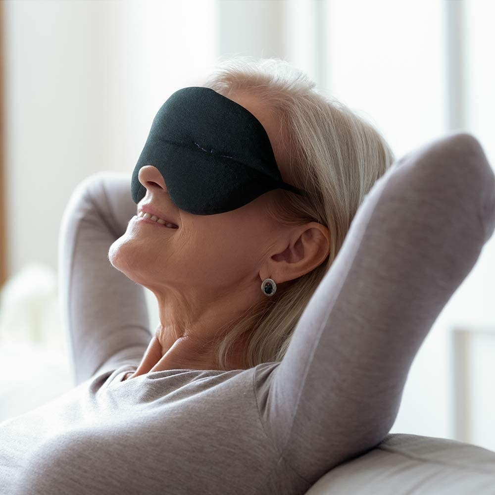 A model wearing the puffy black fabric eye mask