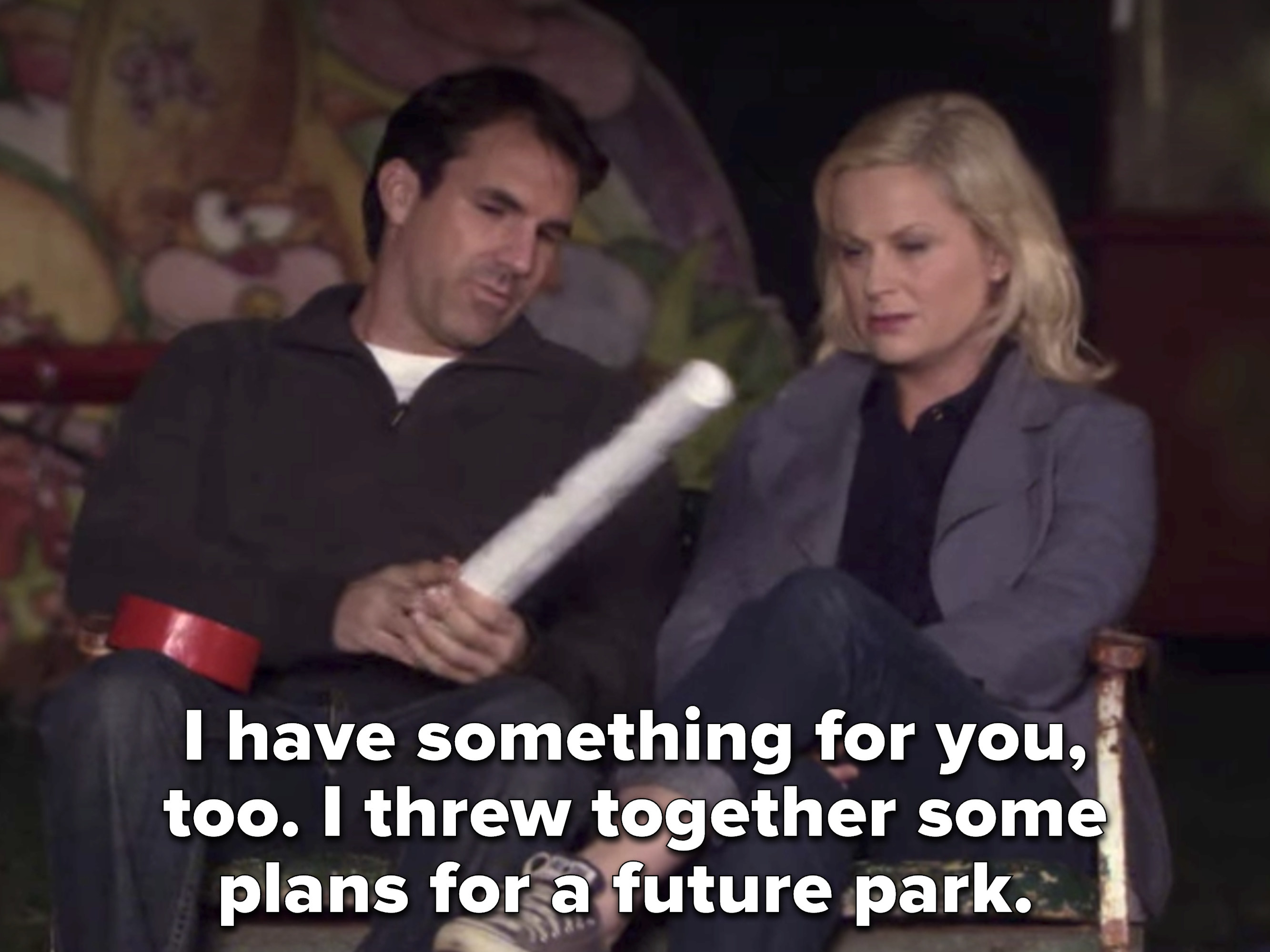 Mark gives Leslie his plans for the park before he leaves