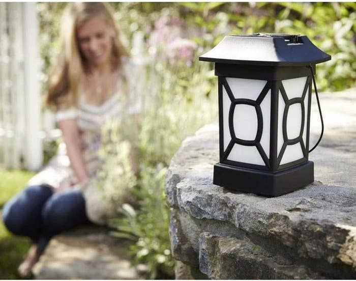 The mosquito-repelling lantern, which looks likes lawn decor