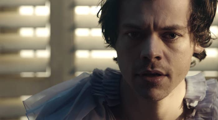 "Harry Styles playing the piano in the ""Falling: music video"
